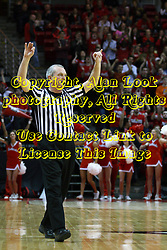 12 January 2013:  Referee Hal Lusk signals a 3 point basket during an NCAA Missouri Valley Conference mens basketball game Where the Bulldogs of Drake University beat the Illinois State Redbirds 82-77 in Redbird Arena, Normal IL