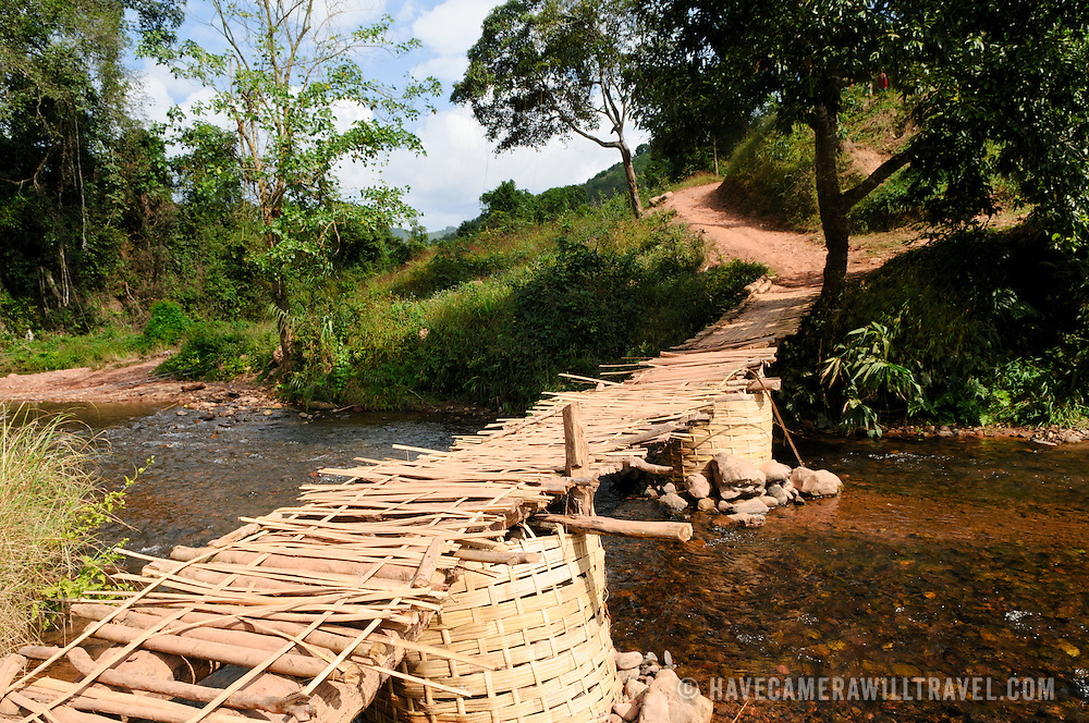 A bamboo bridge spanning a small creek leading to Lakkhamma Village in Luang Namtha province in northern Laos. Lakkhamma Village was established as a joint project between the Lao government and the European Commission.