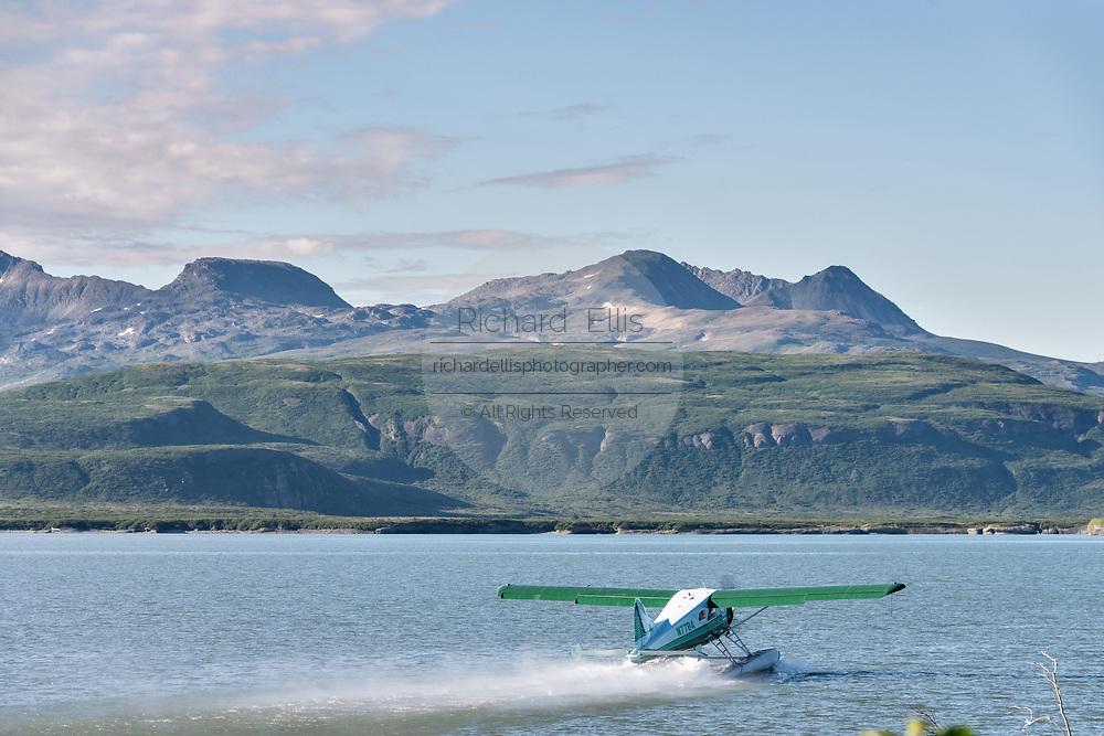 A Dehavilland Beaver float plane takes off from the lagoon at the McNeil River State Game Sanctuary on the Kenai Peninsula, Alaska. The remote site is accessed only with a special permit and is the world's largest seasonal population of brown bears.