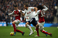 Harry Kane of Tottenham Hotspur (c) takes on Granit Xhaka (L) & Mohamed Elneny of Arsenal (R). Premier league match, Tottenham Hotspur v Arsenal at Wembley Stadium in London on Saturday 10th February 2018.<br /> pic by Steffan Bowen, Andrew Orchard sports photography.