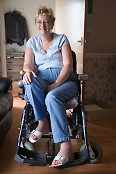 Woman wheelchair user smiling,