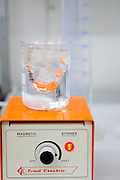 Magnetic stirrer in a laboratory the effect on the liquid can be seen