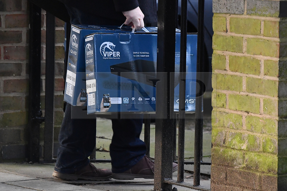 © Licensed to London News Pictures. 03/02/2020. London, UK. Video recording equipment being taken in to a bail hostel in Steatham, South London used by Sudesh Amman, near the scene on Streatham High Road where a man was shot dead by police yesterday after a number of people were stabbed. Metropolitan Police declared the incident terrorist-related. Photo credit: Ben Cawthra/LNP