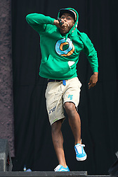 © London News Pictures. 25/08/2012. Reading, UK. Tyler, The Creator performing with Odd Future' on the main stage on day two of Reading Festival 2012 in Reading, Berkshire, UK on August 25, 2012. The three day event which attracts over 80,000 music fans headlines The Cure, Kasabian and The Foo Fighters Photo credit : Ben Cawthra/LNP