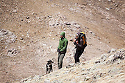 Kate Clark, Brian Bernhardt and their dog Zapata ramble through the alpine above Parika Lake, Never Summer Wilderness, Colorado.