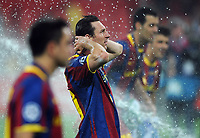 Football - UEFA Champions League Final - Barcelona vs. Manchester United<br /> Lionel Messi of Barcelona celebrates in the water sprinklers at Wembley Stadium, London