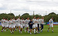 Photo: Paul Thomas.<br /> England training at Carrington. 30/08/2006. <br /> <br /> <br /> John Terry (C) and England.