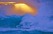 """A stormy sunrise seen from Halona Cove, the beach where the risque love seen with Burt Lancaster and Deborah Kerr in """"From Here to Eternity"""" was filmed in the 1950's - Oahu, Hawaii."""
