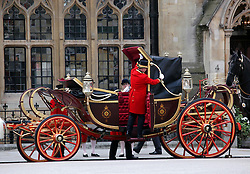 29 April 2011. London, England..Royal wedding day. Footmen take down the roof on the convertible royal wedding carriage outside Westminster Abbey..Photo; Charlie Varley.