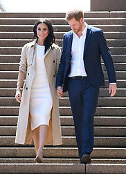 Prince Harry The Duke of Sussex and a pregnant Meghan Duchess of Sussex on a public walkabout at the Sydney Opera House. Photo credit should read: Doug Peters/EMPICS