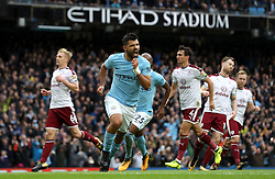 """Manchester City's Sergio Aguero celebrates scoring his side's first goal from the penalty spot, equaling Manchester City's all-time scoring record during the Premier League match at the Etihad Stadium, Manchester. PRESS ASSOCIATION Photo. Picture date: Saturday October 21, 2017. See PA story SOCCER Man City. Photo credit should read: Martin Rickett/PA Wire. RESTRICTIONS: EDITORIAL USE ONLY No use with unauthorised audio, video, data, fixture lists, club/league logos or """"live"""" services. Online in-match use limited to 75 images, no video emulation. No use in betting, games or single club/league/player publications."""