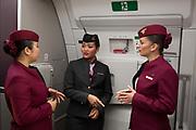 Qatar Airways cabin crew in an Airbus A350-1000 at the Farnborough Airshow, on 18th July 2018, in Farnborough, England.