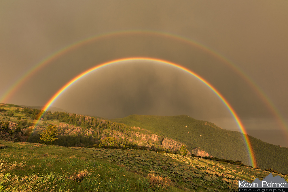 A weakening storm approached the west side of the Bighorn Mountains. The sun came out and this double rainbow appeared. It was so vivid it felt like I could reach out and touch it. At first it was almost a complete circle. I rushed to capture a time lapse and had to keep wiping the raindrops off my lens. I got quite wet as a result, but it was worth it.<br /> <br /> A double rainbow is caused by light reflecting a second time within raindrops. The secondary rainbow is located 8° apart from the primary bow, and is almost double the width. The colors are fainter, and in reverse order (VIBGYOR instead of ROYGBIV.) In between the two rainbows is a darkened part of the sky called Alexander's Band. The sunlight is always brightest in the center of a rainbow at the anti-solar point. But since this bright light is also reflected opposite the secondary rainbow, that leaves a dark band in between.