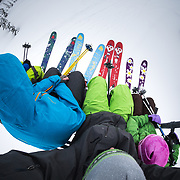 Tyler Hatcher, Owen Dudley, Jay Goodrich, and Jade Goodrich ride a chair to the top of Mount Baker Ski Area while wearing Mammut and Wagner Custom Skis.