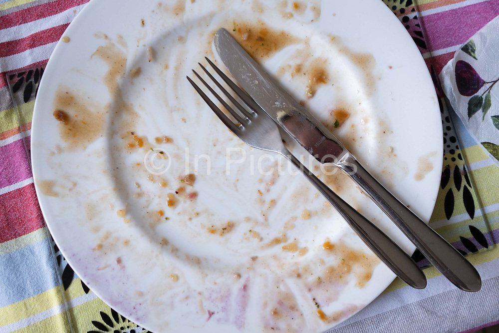 No turkey left on an empty plate after a family Christmas Day lunch in south London, on 25th December 2020 in London, England. Christmas lunch or dinner in the UK is the main meal during the December Christian celebration, when families traditionally come together for the high-protein turkey and high-fibre vegetables - one of the most nutritious meals of the year.
