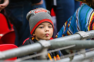 A young Wolverhampton Wanderers fan during the The FA Cup semi-final match between Watford and Wolverhampton Wanderers at Wembley Stadium, London, England on 7 April 2019.