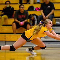 Bloomfield Bobcat Halle Payne (7) dives to save a serve from the Miyamura Patriots Tuesday at Miyamura High School.