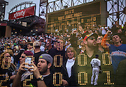 """""""Seventh Inning Stretch."""" White Sox opening day on Monday, March 31, 2014 at U.S. Cellular Field. Made with three exposures in camera. (Brian Cassella/Chicago Tribune) B583640404Z.1 <br /> ....OUTSIDE TRIBUNE CO.- NO MAGS,  NO SALES, NO INTERNET, NO TV, CHICAGO OUT, NO DIGITAL MANIPULATION..."""