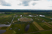 Nederland, Drenthe, Gemeente Borger-Odoorn, 30-06-2011; LOFAR (Low Frequency Array - lage frequentie telescoop), ten noorden van Exloo. Centrale gedeelte van de radiotelescoop. De gehele radiotelescoop bestaande uit vele duizenden aan elkaar gekoppelde antennes welke staan op de grijze tegels. Deze antennes bevinden zich op andere locaties, het geheel wordt beheerd door ASTRON. In het kader van het natuurbeheer zijn de oude meanders van het Achterste Diep hersteld. .LOFAR (Low Frequency Array - Low Frequency telescope), north of Exloo. Central portion of the radio telescope..The entire radio telescope consists of thousands of interconnected antennas, the antennas are located on different sites, all operated by ASTRON..luchtfoto (toeslag), aerial photo (additional fee required).copyright foto/photo Siebe Swart