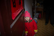 Zhao Jing stands by the door to her apartment in the Wujianong neighborhood of Hefei, China, on Thursday, Nov. 26, 2015. Cheap housing in the neighbourhood and its closeness to the regional children hospital has made it a popular long term stay option for many families with kids suffering from caner, notably Leukaemia, as Surging health-care costs are turning into one of the biggest threats to the world's second largest economy and its consumers.
