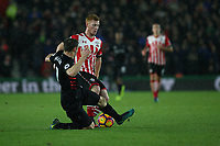 Football - 2016 / 2017 Premier League - Southampton vs. Liverpool<br /> <br /> James Milner of Liverpool slides in to stop Southampton's Harrison Reed from setting up a Southampton attack at St Mary's Stadium Southampton England<br /> <br /> COLORSPORT/SHAUN BOGGUST