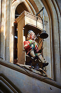 """Figure of the Wells clock, 1390, in the the medieval Wells Cathedral built in the Early English Gothic style in 1175, Wells Somerset, England . Its Gothic architecture is mostly in Early English style of the late 12th – early 13th centuries. Building began about 1175 at the east end with the choir. Historian John Harvey sees it as Europe's first truly Gothic structure. Its Early English front with 300 sculpted figures, is seen as a """"supreme triumph of the combined plastic arts in England"""".<br /> <br /> Visit our MEDIEVAL PHOTO COLLECTIONS for more   photos  to download or buy as prints https://funkystock.photoshelter.com/gallery-collection/Medieval-Middle-Ages-Historic-Places-Arcaeological-Sites-Pictures-Images-of/C0000B5ZA54_WD0s"""