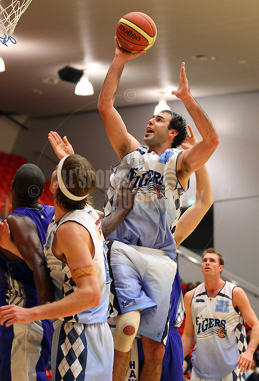 PERTH, AUSTRALIA - JULY 16: Mark Jones of the Tigers lays up during the week 18 SBL game between the Perry Lakes Hawks and the Willetton TIgers at The State Basketball Center on July 16, 2011 in Perth, Australia.  (Photo by Paul Kane/Allsports Photography)