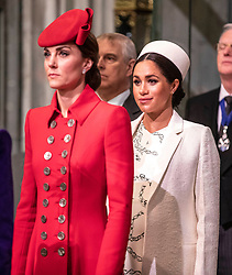 The Duchess of Cambridge (left) with the Duchess of Sussex (right) as they attend the Commonwealth Service at Westminster Abbey, London.