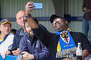 AFC Wimbledon faking selfie during the EFL Sky Bet League 1 match between AFC Wimbledon and Rochdale at the Cherry Red Records Stadium, Kingston, England on 5 October 2019.
