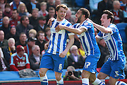 Brighton central midfielder Dale Stephens celebrates after making it 1-0 during the Sky Bet Championship match between Brighton and Hove Albion and Burnley at the American Express Community Stadium, Brighton and Hove, England on 2 April 2016. Photo by Bennett Dean.