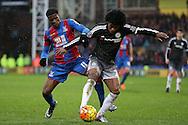 Wilifried Zaha of Crystal Palace and Willian of Chelsea compete for the ball. Barclays Premier League match, Crystal Palace v Chelsea at Selhurst Park in London on Sunday 3rd Jan 2016. pic by John Patrick Fletcher, Andrew Orchard sports photography.