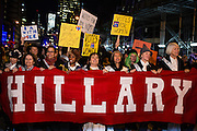 "New York, NY - 31 October 2016. Marchers in support of Hillary Clinton marrch behind a banner that simply reads ""Hillary"" in the annual Greenwich Village Halloween parade."
