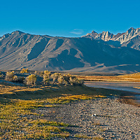 A photographer focuses on McGee Mountain, Mount Baldwin, The White Fang and Mount Morrison of the Eastern Sierra Nevada crest above Big Alkali Lake and Long Valley near Mammoth Lakes, California.