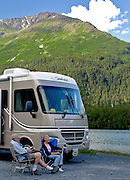 Alaska. Scenic view of recreational campers enjoying a relaxing summer evening along the Portage River, Chugach National Forest. (Model Release)