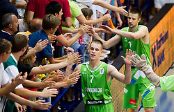 Klemen Prepelic of Slovenia, Matej Rojc of Slovenia celebrate after winning the basketball match between National teams of Turkey and Slovenia in Qualifying Round of U20 Men European Championship Slovenia 2012, on July 17, 2012 in Domzale, Slovenia. Slovenia defeated Turkey 72-71 in last second of the game. (Photo by Vid Ponikvar / Sportida.com)