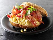 Crispy backon and scrambled eggs on a bagel