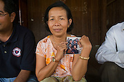 KHMER ROUGE CHRISTIANS. South East Asia, Cambodia, Pailin. Several high ranking ex Khmer Rouge officials including the notorious former Khmer Rouge prison chief Kaing Khek Lev, also known as Duch, have sympathies towards Christianity and Evangelism. Some have changed religion or even become Evangelist priests and pasteurs. Ex-Khmer Rouge buddhists have something to fear: Buddhism offers neither redemption or forgiveness; the Karma and the next life are affected by the present one. On the other hand, Christianity and Evangelism allow one to be born again, it forgives our sins and offers redemption. This proposition is far more attractive to those who orchestrated, organised and carried out mass murder, and torture on a grand scale, against the Cambodian people, leaving 2 million dead in the 1970's. American priests are working in Khmer Rouge strongholds, bringing their Evanglist message, and are having some success. Approved rules for UN-backed Khmer Rouge genocide trials are now in place. The highest ranking Duch is in prison, in Phnom Penh, ready to be tried. What role the Evangelists will play in this scenario is yet to be seen.///The sister of Duch, Khmer Rouge prison chief Kaing Khek Lev, holding his portrait