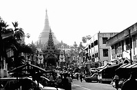 """BURMA (MYANMAR) Yangon Division, Yangon. 2006. The great golden glory of Burma, Yangon?s Shwedagon """"Paya"""", or temple, rises above the whole city.  This Buddhist temple is a national icon, a treasure of imagery and detail."""