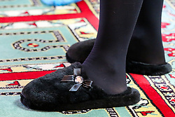 © Licensed to London News Pictures. 07/04/2021. London, UK. Camilla, Duchess of Cornwall wearing slipper during a visit to the London Islamic Cultural Society and Mosque (also known as Wightman Road Mosque) in Haringey, north London. The Mosque was formed by a small group of Guyanese Muslims and now supports over 30 different nationalities and community in Haringey and surrounding boroughs. Photo credit: Dinendra Haria/LNP