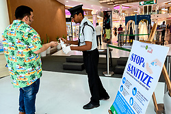 March 17, 2020, Kolkata, West Bengal, India: Security personnel provide hand sanitizer to arriving customers at the entrance of a shopping mall. 137 confirmed cases of COVID-19 have been registered today in India, with Maharasthra being the epicenter of the outbreak with 36 confirmed cases. (Credit Image: © Debarchan Chatterjee/ZUMA Wire)