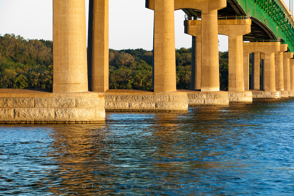 The I-80 Bridge crosses the Mississippi River near Le Claire, Iowa. The massive footings in the evening light make an imposing statement to vessels traveling on the river near the Quad Cities and surrounding rural areas.