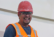 A Construction worker indoors on a building project in Anchorage Alaska