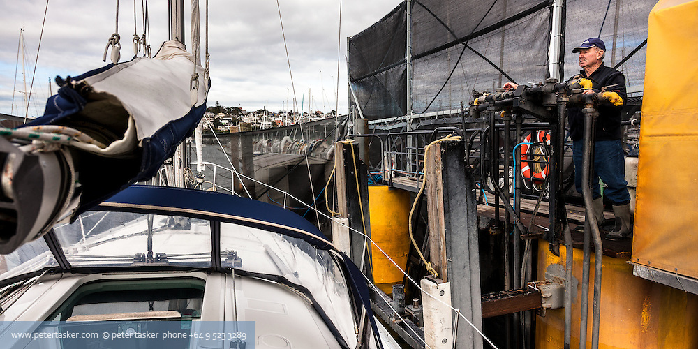 Floating Dock, Westhaven, Auckland. Ken operating the air controls.