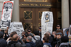 © Licensed to London News Pictures.  15/06/2012. LONDON, UK. Activists, led by a new Orleans style jazz band playing funeral songs, carry cardboard coffins protesting against human rights abuses in the mining industry. The group visited buildings associated with mining including the London Stock Exchange and the London Metal Exchange and protested against mining companies Rio Tinto, Glencore and Xstrata. Photo credit :  Cliff Hide/LNP