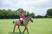 JUNIOR POLO PLAYER, The Dalwhinnie Crook  charity Polo match  at Longdole  Polo Club, Birdlip  hosted by the Halcyon Gallery. . 12 June 2010. -DO NOT ARCHIVE-© Copyright Photograph by Dafydd Jones. 248 Clapham Rd. London SW9 0PZ. Tel 0207 820 0771. www.dafjones.com.