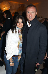 GARY KEMP and his wife LAUREN at a party to celebrate the opeing of the new Paul & Joe Boutique at 134 Sloane Street, London SW1 on 14th April 2005.<br />