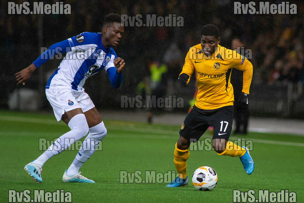 BERN, SWITZERLAND - NOVEMBER 28: #15 Mamadou Ndiyae of FC Porto battles for the ball with #17 Roger Assale of BSC Young Boys during the UEFA Europa League group G match between BSC Young Boys and FC Porto at Stade de Suisse, Wankdorf on November 28, 2019 in Bern, Switzerland. (Photo by Monika Majer/RvS.Media)