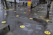 Yellow social distancing stickers remain on the pavement outside the London College of Cummincation LCC during the third lockdown of the Coronavirus pandemic, at Elephant & Castle, on 20th January 2021, in London, England. Universities are still closed to students, with lectures continuing online after the Christmas break accordng to government restrictions, helping to reduce infection rates in the capital at a time when the UK has the highest death rates per 100,000.