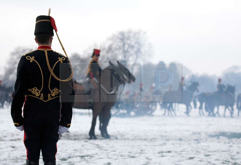 © Licensed to London News Pictures. 06/02/2012. LONDON, UK. A soldier of the Kings Troop Royal Horse Artillery watches on as other members of his unit prepare to leave Hyde Park after firing a 41 gun salute. Gunners of the Kings Troop, based at St John's Wood since 1947, today (06/02/12) left their barracks for the last time to fire their guns in Hyde Park, the soldiers will move tomorrow to their new home in Woolwich. Photo credit: Matt Cetti-Roberts/LNP