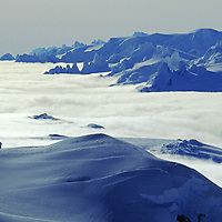 A rare view of the icy spires east of Chile's huge southern icecap (under clouds), viewed from the Cordillera Sarmiento, to its south.